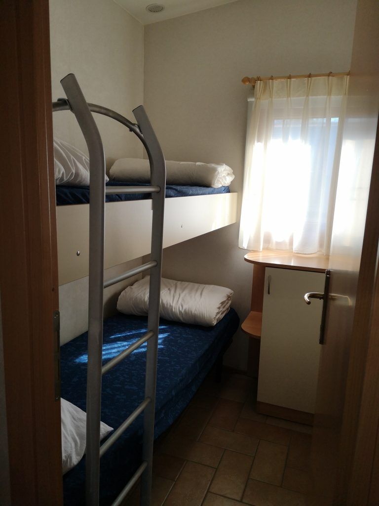 Slaapkamer Chalet Di Fina van CasaToscane