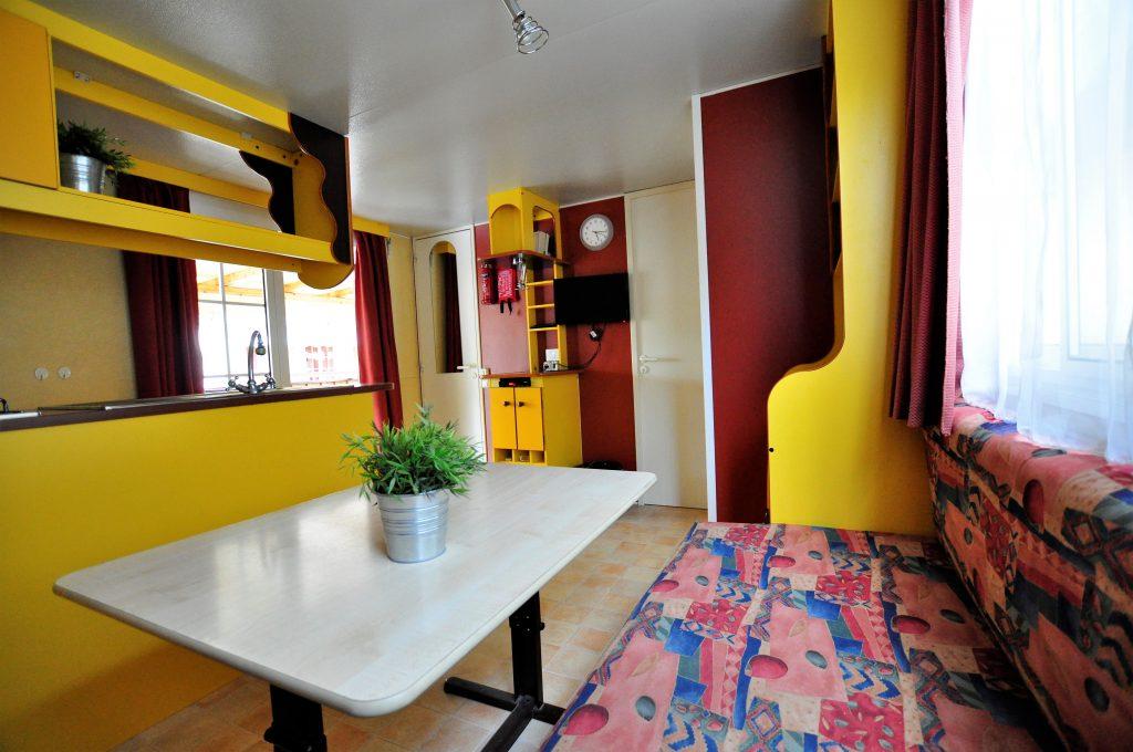 Huiskamer met zithoek in Chalet van CasaToscane