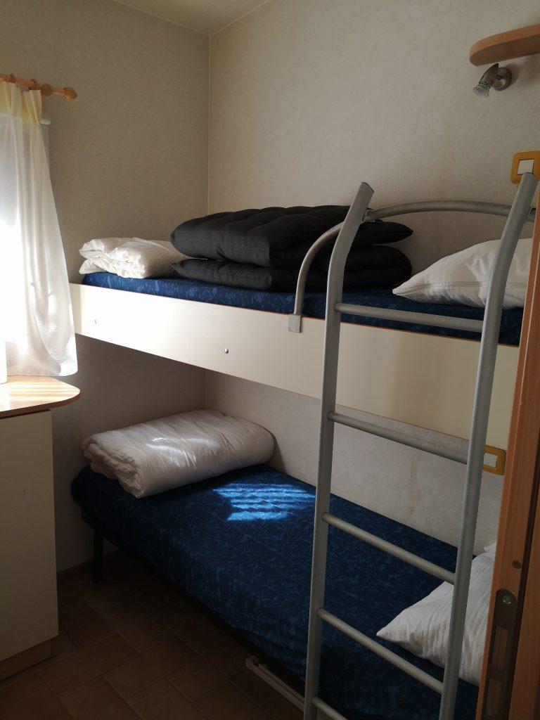 Slaapkamer in Chalet Di Fina van CasaToscane